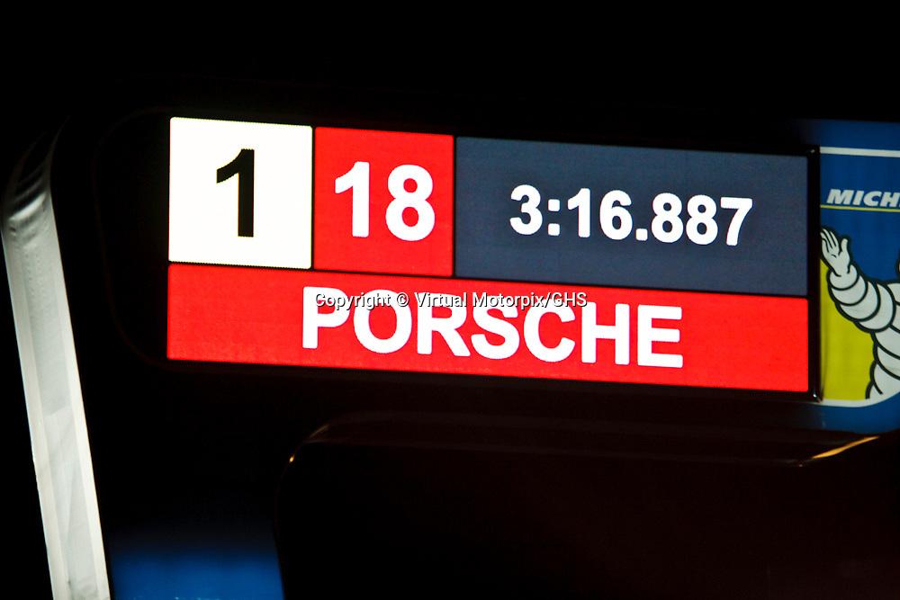 #18 Porsche 919 Hybrid, Porsche Team, LMP1, drivers: Romain Dumas, Neel Jani, Marc Lieb (on the board shown is the record lap time set by Neel Jani) at Le Mans 24H, 2015