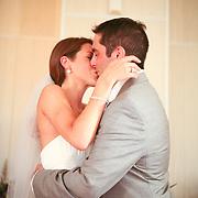A Bride and Groom share an intimite 'first' kiss during fall Maine Wedding.