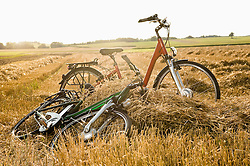 Electric bicycles on grain field against sky, Bavaria, Germany