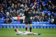 Referee M Salisbury waves on the medics after a serious injury to Coventry City midfielder Luke Thomas (23) during the EFL Sky Bet League 1 match between Peterborough United and Coventry City at London Road, Peterborough, England on 16 March 2019.