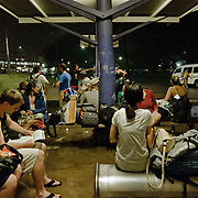 Aboard a greyhoung coach on the east coast road of Australia. Young people, backpackers, waiting to go aboard.