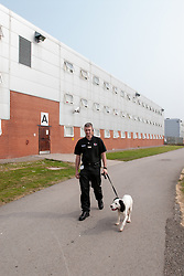 Prison dog team search for drugs