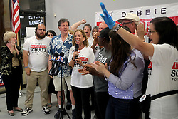 Rep. Debbie Wasserman Schultz (D-Fla.), middle, celebrates victory as election results come in along with campaign volunteers, local candidates, and elected officials, at her campaign's headquarters in Davie, Fla., on Tuesday, Nov. 6, 2018. Photo by Mike Stocker/Sun Sentinel/TNS/ABACAPRESS.COM