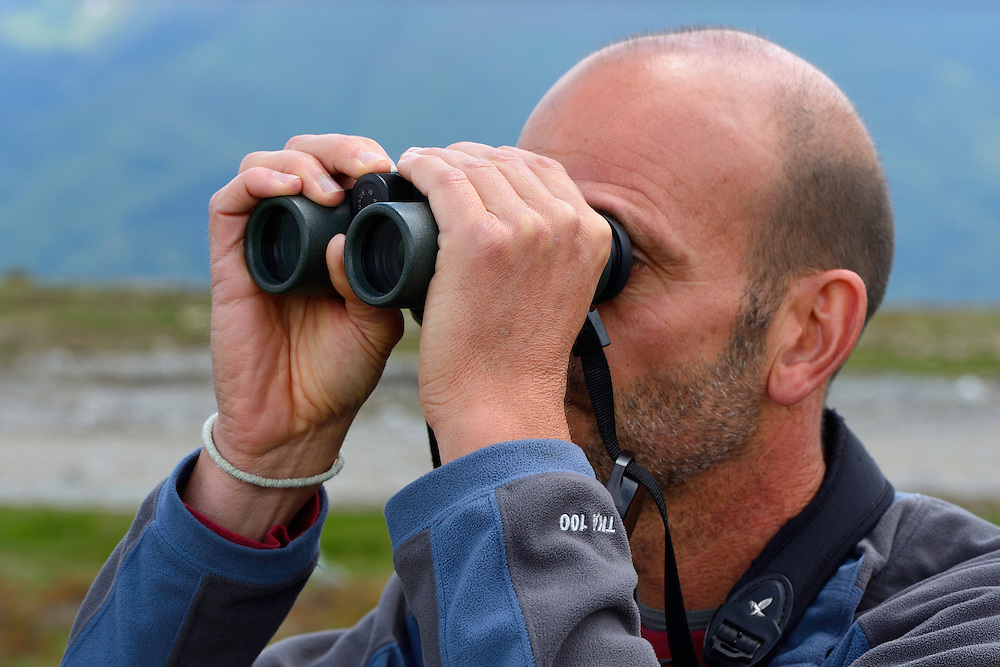 Deli Saavedra, Rewilding Europe regional manager, birdwatching in the Tarcu mountains nature reserve, Natura 2000 area, Southern Carpathians, Romania. The release was actioned by Rewilding Europe and WWF Romania in May 2014.