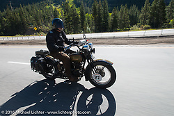 David Cava riding his 1921 Harley-Davidson on Interstate 70 during Stage 10 (278 miles) of the Motorcycle Cannonball Cross-Country Endurance Run, which on this day ran from Golden to Grand Junction, CO., USA. Monday, September 15, 2014.  Photography ©2014 Michael Lichter.