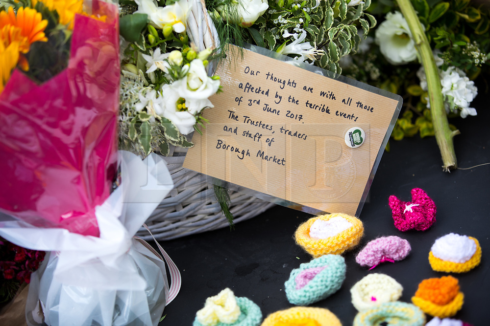 © Licensed to London News Pictures. 03/06/2018. London, UK. A note left on flowers from the staff of Borough Market, marking one year since the London Bridge and Borough Market terror attacks. A series of events have taken place throughout the day, including a service of commemoration at Southwark Cathedral, the planting of an olive tree in the Cathedral grounds, a minute's silence at 4:30pm and the laying of flowers.  Photo credit : Tom Nicholson/LNP