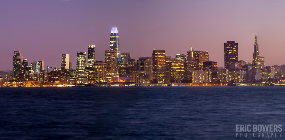 San Francisco dusk-lit skyline view with Salesforce Tower seen from Treasure Island, 2019.