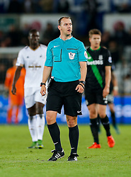 Referee Robert Madley looks on - Mandatory byline: Rogan Thomson/JMP - 07966 386802 - 19/10/2015 - FOOTBALL - Liberty Stadium - Swansea, Wales - Swansea City v Stoke City - Barclays Premier League.