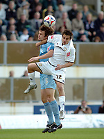 Photo: Kevin Poolman.<br />Milton Keynes Dons v Tranmere Rovers. Coca Cola League 1. 29/04/2006. MK's Filipe Morais and Ian Sharps both go up for the ball.