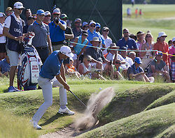 June 16, 2017 - Erin, Wisconsin, U.S. - DUSTIN JOHNSON hits out of a bunker on the 9th hole during the second round of the U.S. Open on Friday. (Credit Image: © Mark Hoffman/TNS via ZUMA Wire)