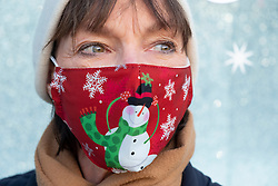 Edinburgh, Scotland, UK. 5 November 2020. Public wearing Christmas themed facemasks on streets of Edinburgh.  Iain Masterton/Alamy Live News