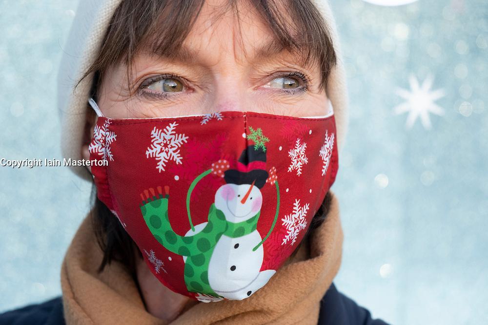 Edinburgh, Scotland, UK. 5 November 2020. Public wearing Christmas themed facemasks on streets of Edinburgh.  Iain Masterton/Alamy Live News