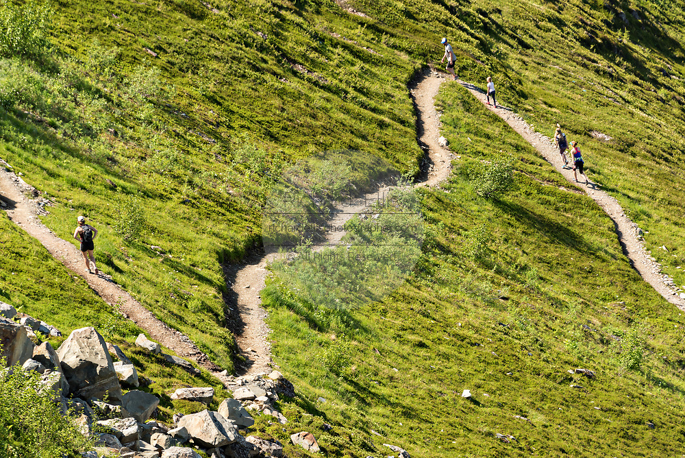 Visitors run the trails to the summit of Mt Alyeska in the Chugach Mountains in Girdwood, Alaska.