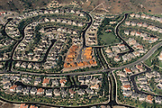 Aerial of Mission Viejo housing subdivisions in Orange County, California, showing the last of new construction at center.