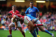 Mike Phillips of Wales is tackled by Italy's Mirco Bergamasco. RBS Six nations championship 2012, Wales v Italy at the Millennium Stadium in Cardiff on Saturday 10th March 2012. pic by Andrew Orchard, Andrew Orchard sports photography