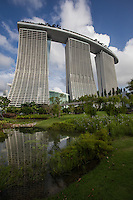 Marina Bay Sands is a multibillion dollar resort at Marina Bay Singapore. The complex was eveloped by Las Vegas Sands and billed as the world's most expensive casino property.  The resort features a 2500 room hotel, a huge convention and exhibition centre, and yet another shopping mall: Shoppes at Marina Bay Sands. There is also a museum, two theatres, seven restaurants, an ice skating rink not to mention its casino itself.  The complex is topped off with a rooftop SkyPark built on top of the cantilevered platform.  The resort was designed by architect Moshe Safdie.