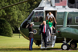 President Donald Trump disembarks from Marine One on the South Lawn with First Lady Melania Trump and his son Barron, after returning to the White House on Aug. 19, 2018 in Washington, D.C. President Trump was returning from the weekend at his Bedminster, New Jersey golf resort. Photo by Pete Marovich/AbacaPress/Pool