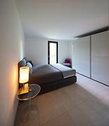 Elegant bedroom with window. Nobody inside