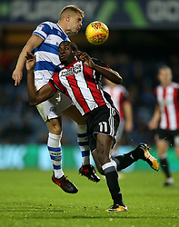 Queens Park Rangers' Jake Bidwell and Sheffield United's Clayton Donaldson in action during the game during the Sky Bet Championship match at Loftus Road, London.