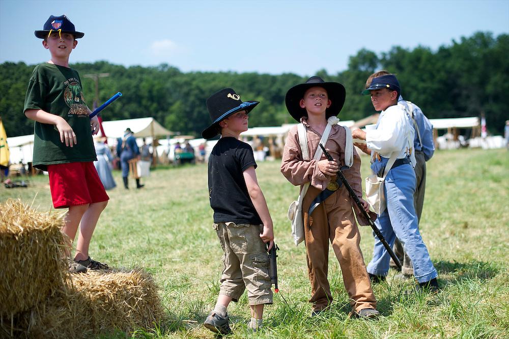 Children play war games during the 149th Gettysburg Reenactment in Gettysburg, Pennsylvania on July 6, 2012.