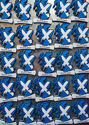 Many fridge magnets in shape of Scottish map with flag for sale in tourist gift shop in Old Town of Edinburgh, Scotland, United Kingdom
