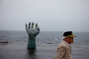 """Visitor at the """"Hand of Harmony"""" located at Homigot Beach close to Pohang city at the South Korean East coast. South Korea, Republic of Korea, KOR, 20.04.2010"""