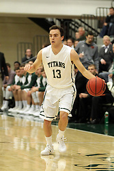 17 November 2015: Bryce Dolan(13) looks for a way inside while maintaining the dribble during an NCAA men's division 3 CCIW basketball game between the Greenville College Panthers and the Illinois Wesleyan Titans in Shirk Center, Bloomington IL