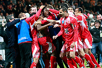 Ajaccio's forward Richard Socrier is congratulated by team mates after scoring a goal during a French L1 football match Ajaccio vs Sochaux in the Francois Coty stadium in Ajaccio on May 2, 2012.  PHOTO PASCAL POCHARD-CASABIANCA / AFP / DPPI