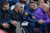 Football - 2019 / 2020 Premier League - West Ham United vs. Tottenham Hotspur<br /> <br /> Jose Mourinho, Manager of Tottenham FC, scribbles notes as coaching staff advise him at the London Stadium<br /> <br /> COLORSPORT/DANIEL BEARHAM