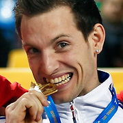 France's Renaud Lavillenie bites his gold medal on the podium during the IAAF World Indoor Championships at the Atakoy Athletics Arena, Istanbul, Turkey. Photo by TURKPIX