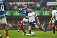 Portsmouth Forward, Oliver Hawkins (9) and Wycombe Wanderers Midfielder, Matt Bloomfield (10) during the EFL Sky Bet League 1 match between Portsmouth and Wycombe Wanderers at Fratton Park, Portsmouth, England on 22 September 2018.