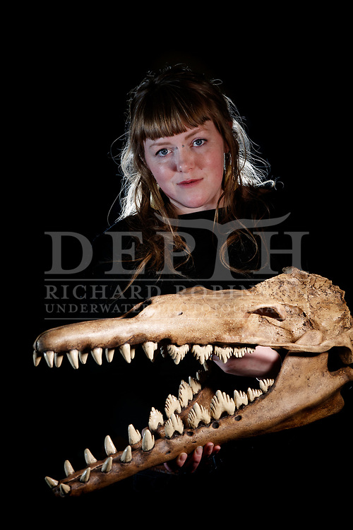 Dunedin's Sophie White prepares the fossilised remains of ancient whales and dolphins for display, including this skull she cast for Duntroon's Vanished World Centre. <br /> Shot on assignment for New Zealand Geographic Issue 164 July - August 2020.<br /> Read the Feature: https://www.nzgeo.com/stories/the-skeleton-crew/<br /> Photograph Richard Robinson © 2020.<br /> Rights managed image. No Reproduction without prior written permission.