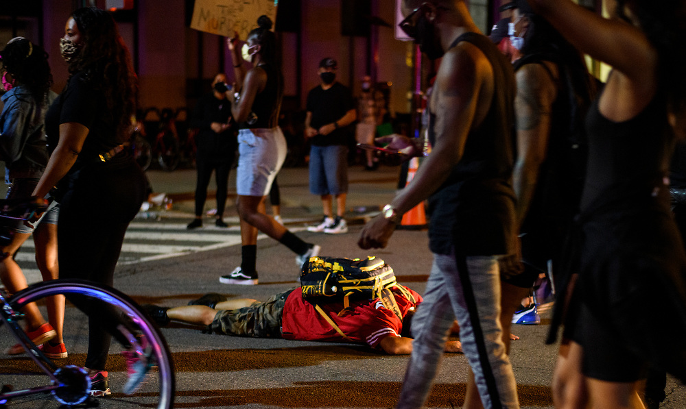 A protester lays down on the hot pavement in protest. Thousands of Black Lives Matter Protesters march from multiple locations and descended onto the newly name Black Lives Matter plaza on 16th and H Street to protest of the killing of George Floyd in police custody, on Saturday, June 6, 2020.