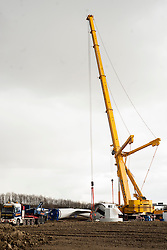 Ulley Wind Farm two massive cranes prepare to lift the first of the four sections that make up the tower into place...13  March  2013.Image © Paul David Drabble