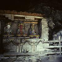 "NEPAL, HIMALAYA. Remote Buddhist ""gompa"" in Hinku Valley, other statues: Buddha (c.) Aralokitashuara (l) (Dalai Lama)"