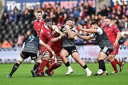 Gareth Thomas of Ospreys is tackled by Jake Ball of Scarlets<br /> <br /> Photographer Craig Thomas/Replay Images<br /> <br /> Guinness PRO14 Round 11 - Ospreys v Scarlets - Saturday 22nd December 2018 - Liberty Stadium - Swansea<br /> <br /> World Copyright © Replay Images . All rights reserved. info@replayimages.co.uk - http://replayimages.co.uk
