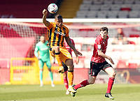 Hull City's Josh Magennis controls under pressure from Lincoln City's Conor McGrandles<br /> <br /> Photographer Rich Linley/CameraSport<br /> <br /> The EFL Sky Bet League One - Lincoln City v Hull City - Saturday 24th April 2021 - LNER Stadium - Lincoln<br /> <br /> World Copyright © 2021 CameraSport. All rights reserved. 43 Linden Ave. Countesthorpe. Leicester. England. LE8 5PG - Tel: +44 (0) 116 277 4147 - admin@camerasport.com - www.camerasport.com
