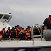 A group of Afghans is seen aboard a rescue boat arriving at Mytilene port in Lesbos island, Greece.