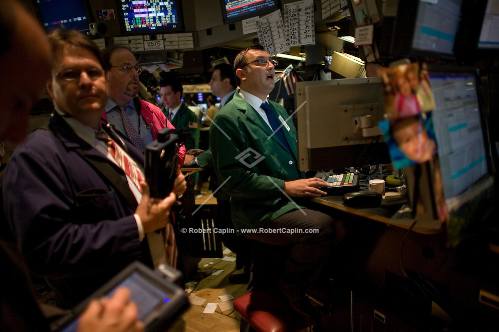 Brokers on the floor of the New York Stock Exchange on a turbulent day for the exchange. The Dow Industrials Suffered a 4.4% Loss of over 500 points.  Lehman Brothers, burdened by $60 billion in soured real-estate holdings, filed a Chapter 11 bankruptcy petition in U.S. Bankruptcy Court after attempts to rescue the 158-year-old firm failed. Bank of America Corp. said it is snapping up Merrill Lynch & Co. Inc. in a $50 billion all-stock transaction. Sept 15, 2008.