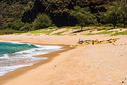 Sea kayaks on Miloli'i Beach, Na Pali Coast, Island of Kauai, Hawaii USA