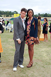 PERCY PARKER and MATILDA MBU at the Veuve Clicquot Gold Cup polo final held at Cowdray Park, Midhurst, West Sussex on 18th July 2010.