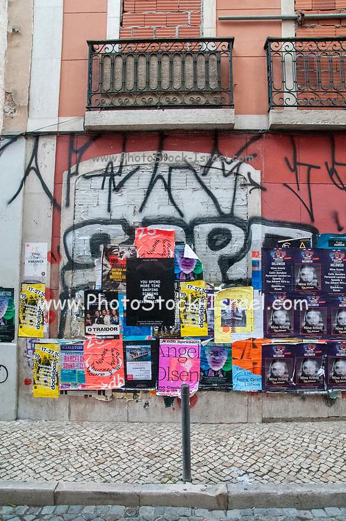 posters and graffiti in rua da Rosa, Lisbon Portugal