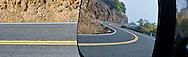 a glance at the rear view mirror shows a curvy road behind in Klickitat Canyon, Klickitat County, Washington, USA