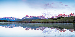 Sunrise over the Sawtooth Range. Early morning reflections at Little Redfish Lake. <br /> <br /> This photo panorama can be printed nicely at 18X36 inches at high resolution, a 1X2 ratio.