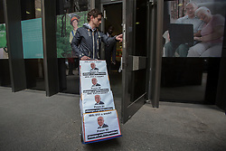© licensed to London News Pictures. London, UK 08/04/2013. A petition calling for Iain Duncan Smith to live on £53 for a week being handed into the Department of Work and Pensions in London. 5 boxes of signatures being delivered by Dominic Aversano who started the petition campaign. Photo credit: Tolga Akmen/LNP