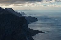 View over rugged northern coast of Moskenesøy from summit of Storskiva mountain peak, Lofoten Islands, Norway