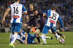 BARCELONA, April 30, 2017  Barcelona's Lionel Messi(2nd R) vies with Espanyol's David Lopez (1st R) and Javi Fuego (2nd L) during the Spanish first division (La Liga) soccer match between RCD Espanyol and FC Barcelona at RCDE Stadium in Barcelona, Spain, April 29, 2017. Barcelona won 3-0. (Credit Image: © Lino De Vallier/Xinhua via ZUMA Wire)