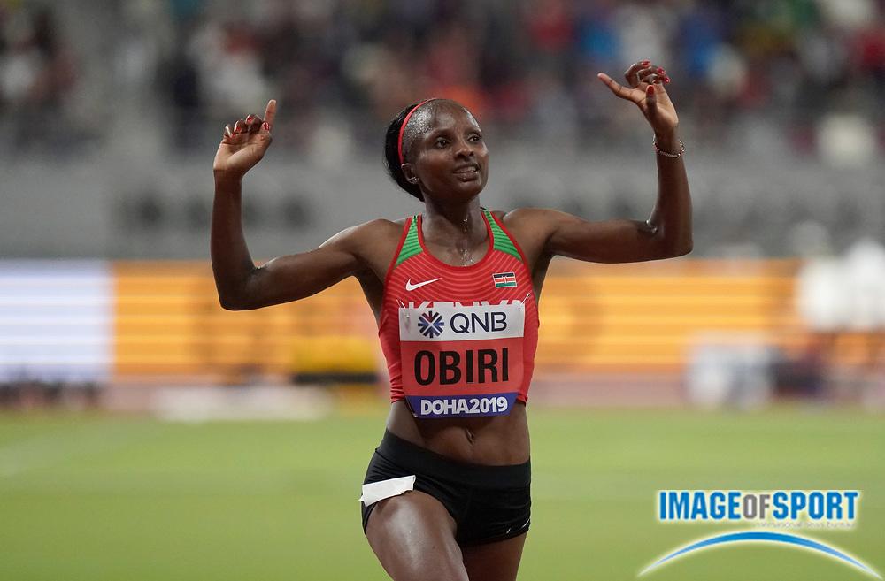 Oct 5, 2019; Doha; Qatar; Hellen Obiri (KEN) celebrates after winning the women's 5,000m in a championship record 14:26.72 during the IAAF World Athletics Championships at Khalifa International Stadium.