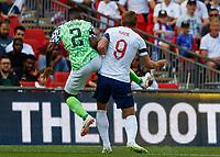 Football - 2018 International Friendly (pre-World Cup warm-up) - England vs. Nigeria<br /> <br /> Bryan Idowu (Nigeria) gets a foot in ahead of Harry Kane (England) at Wembley Stadium.<br /> <br /> COLORSPORT/DANIEL BEARHAM