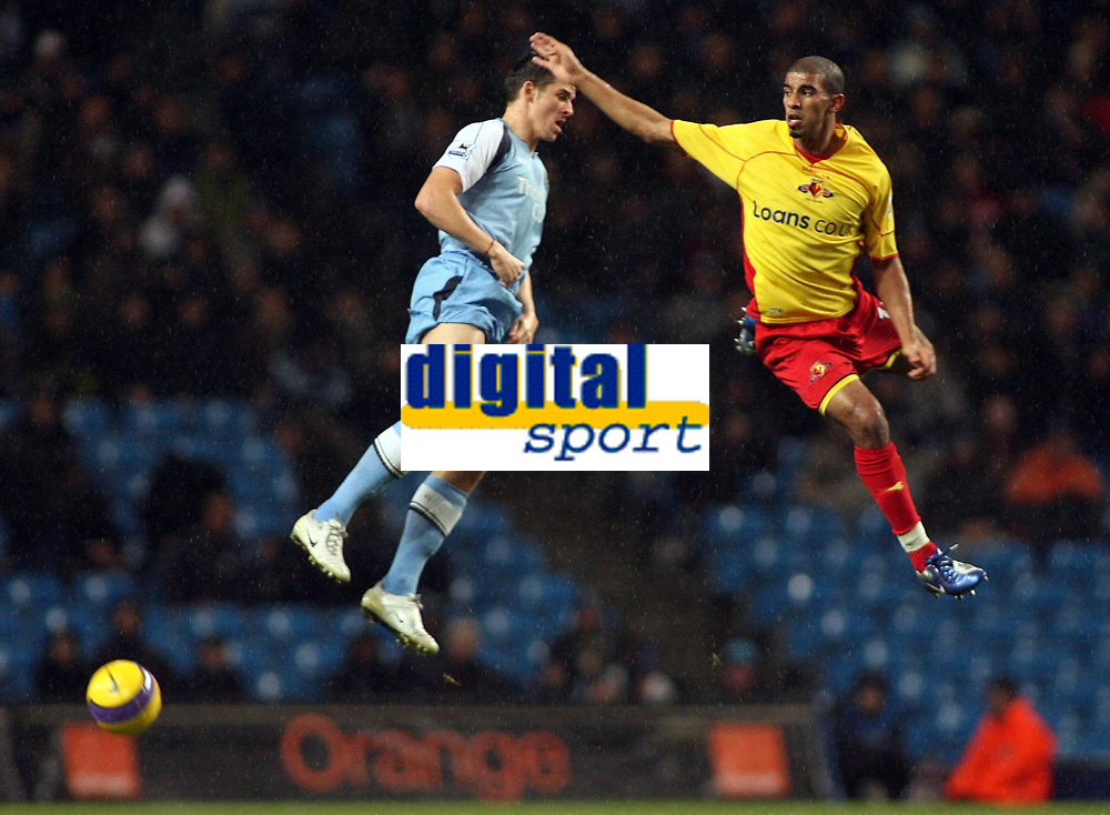 Photo: Paul Thomas.<br /> Manchester City v Watford. The Barclays Premiership. 04/12/2006.<br /> <br /> Joey Barton of Man City looses a header to Hamer Bouazza (R) of Watford.